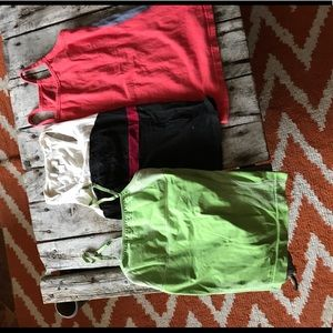 3 tank tops in GUC. Size small and one kid size 14